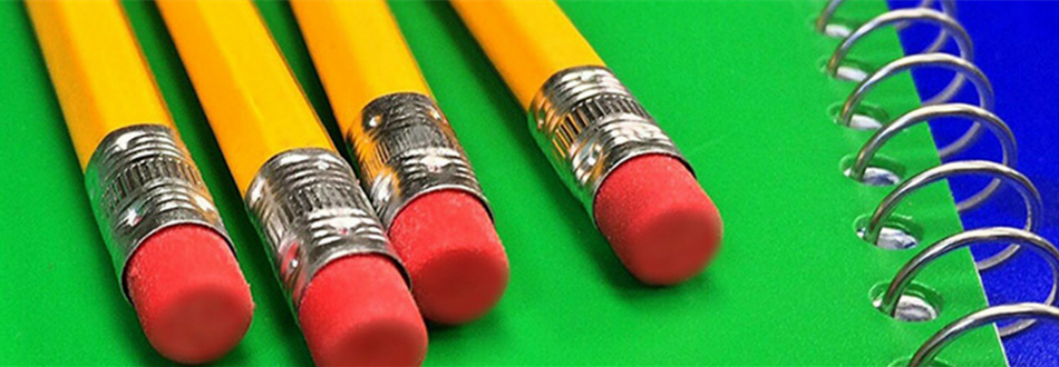Photo of pencils and a notebook which link to the suggested school supplies lists for mMiddle school.