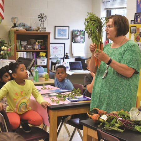 Clark Creek Elementary School STEM Academy teacher Karen Garland, shown teaching in her classroom last school year using vegetables grown by students in the school garden, is the 2020 Georgia Farm Bureau Agriculture in the Classroom Teacher of the Year. 'I have witnessed firsthand that learning happens when children are excited, motivated and interested in the materials being presented,' she said.