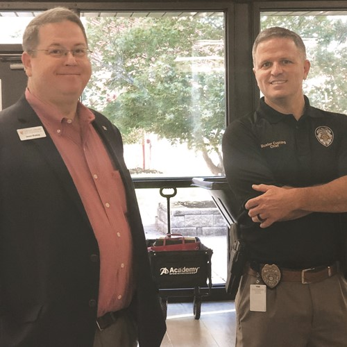 Credit Union of Georgia Branch Manager Jason Blakey, left, and CCSD School Police Chief Buster Cushing enjoy the event.