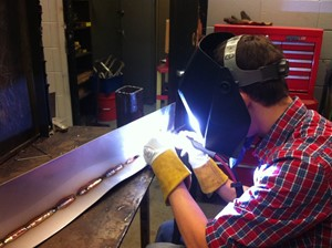 Cherokee student TIG welding stainlees support